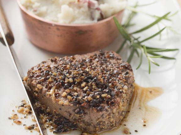 Steak mit Pfeffer dazu Kartoffelbrei