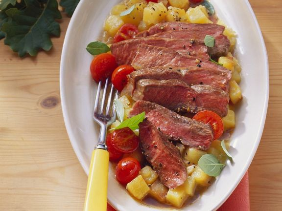 Steakstreifen auf Kartoffelgemüse