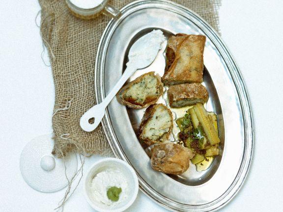 Stockfischgebäck mit Brickteig