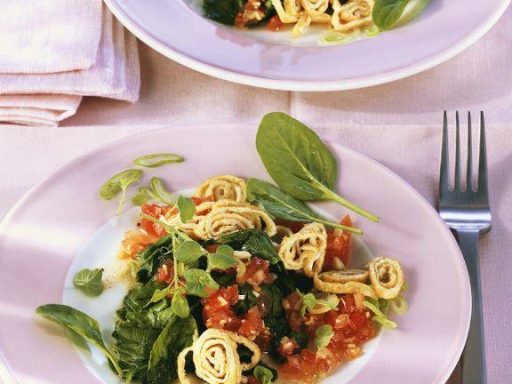 Tomaten-Spinatragout mit Pfannkuchenstreifen