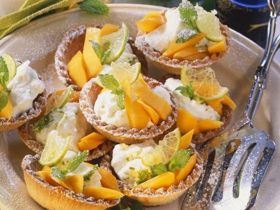 Torteletts mit Papaya und Zitrussahne