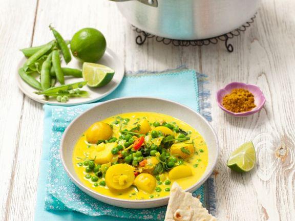 Vegetarisches Curry mit Erbsen und Kartoffeln