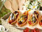 Blätterteig-Törtchen mit Tomaten und Sardellen Rezept