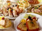 Buffet mit Schinkenrollen, Pasteten, belegten Broten etc. Rezept