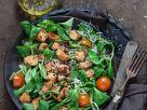 Feldsalat mit gebratener Hähnchenbrust, Tomaten und Parmesan Rezept