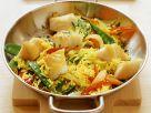 Fisch-Reis-Pfanne mit Zuckerschoten und Paprika Rezept