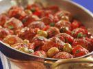 Fleischbällchen mit Tomaten und Oliven Rezept