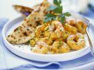 Garnelen mit Currysauce und Fladenbrot Rezept