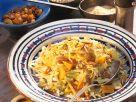 Gemüsereis mit Mandeln und Rosinen Rezept