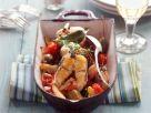 Geschmorter Aal mit Tomaten und Kapernäpfeln Rezept