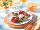 Gratinierte Schweinefiletsteaks auf Artischockenböden mit geschmorten Tomaten Rezept