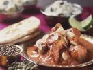 Hähnchen mit Mandelblättchen auf indische Art Rezept