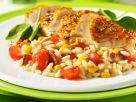 Hähnchen mit Risotto, Speck, Tomaten und Mais Rezept