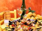 Hähnchen-Paella mit Muscheln und Scampi Rezept