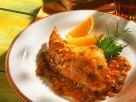 Kaninchen mit Tomatensauce aus dem Römertopf Rezept