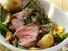 Kräuter-Lammkeule mit grünen Bohnen Rezept