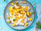 Limetten-Kokos-Milchreis mit Mango-Ananas-Salat und Minze Rezept