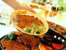 Marinierte Schweineschnitzel vom Grill Rezept
