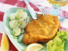 Paniertes Putenschnitzel mit Kartoffelsalat Rezept