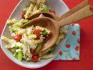 Pasta mit Tomaten, Lauch und Haselnüssen Rezept