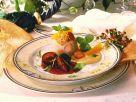 Punsch-Parfait mit Rotweinpflaumen und Orangensoße Rezept