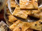 Quarkkuchen mit Rosinen und Mandeln Rezept