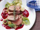 Rehnüsschen mit Rosenkohl, Preiselbeersoße und Sellerieauflauf Rezept