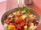 Reispfanne mit Paprika, Fleisch und Speck Rezept