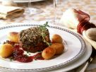 Rindermedaillon mit Steinpilzhaube und Zwiebeln in Rotwein Rezept