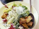 Römersalat mit Knoblauchsprossen und Artischockenherzen Rezept