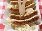 Sauerkraut mit Bratwürsten Rezept