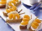 Schmetterlings-Kuchen mit Marzipan und Mandarinen Rezept