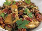 Schmor-Kaninchen mit Pilzen und Zwiebeln Rezept