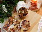 Schokorolle mit Trockenfrüchten und Nüssen Rezept