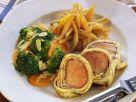 Schweinefilet im Pfannkuchenmantel mit Schupfnudeln und Gemüse Rezept