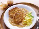 Schweinesteak mit Zwiebel-Sahne-Sauce Rezept