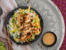Tofu-Erdnuss-Spieße mit Mango-Koriander-Reis und Erdnusskernen Rezept