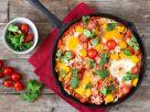 Tomaten-Reis-Shakshuka mit Paprika Rezept