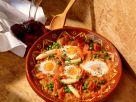 Tomatenpfanne mit gestocktem Ei Rezept