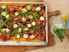 Vegane Polentapizza mit Zucchini, Pilzen, Oliven und Rucola Rezept
