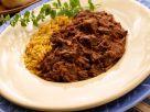 Würziger Schweinefleischeintopf mit Reis Rezept